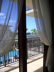 Ko Olina condo photo - Enter Lanai from Bedroom/Pool & Ocean View