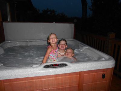 Lake James cabin rental - Enjoying the hot tub after a day of activities.