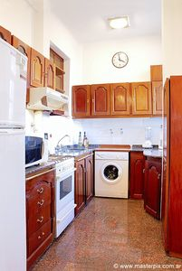 Kitchen also has a washing machine with dryer in it. Fully furnished