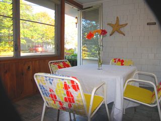 Mashpee house photo - Enjoy the ocean breeze on the front porch with dining table and day bed