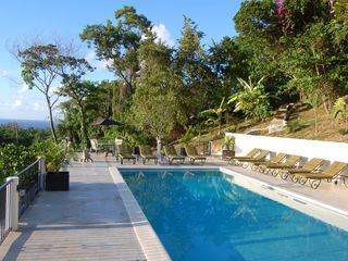 Runaway Bay villa photo - pool with view of ocean and tropical gardens around