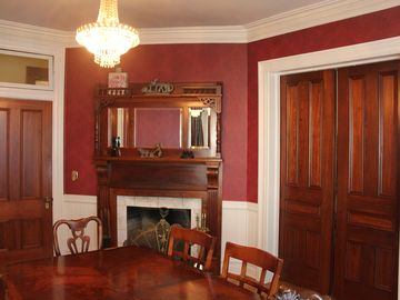 Dining Room has working fireplace and pocket doors lead to Parlour