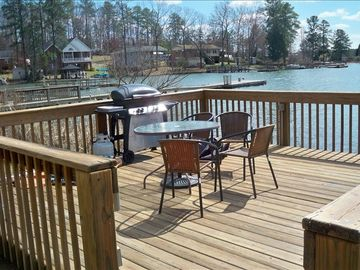 Gas grill and eating area on dock