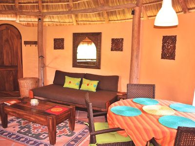 round living area with palapa roof