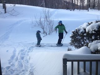 Jay Peak condo photo - My wife and 4 yr old headed to trail right off deck to rip some Powder!!!