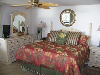 Fort Myers Beach condo photo - Enjoy relaxing in your comfortable king bed while viewing the water.
