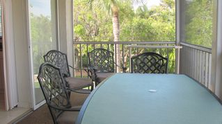 Sanibel Island condo photo - large screened lanai for outdoor eating and relaxing