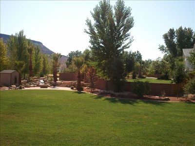 backyard area and water feature with wood fire pit and picnic area