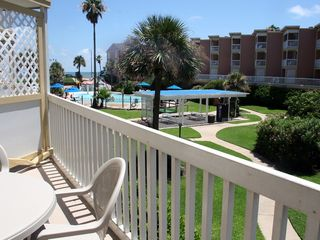Galveston condo photo - Large patio with table and chairs.