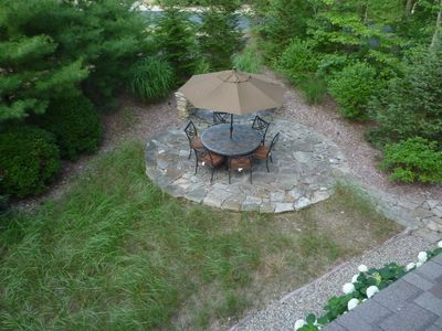 Patio with fire pit. View from balcony.