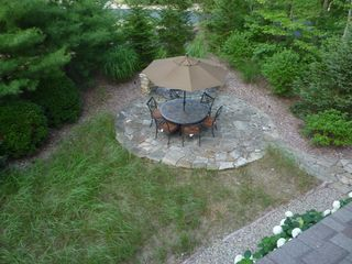 New Buffalo house photo - Patio with fire pit. View from balcony.