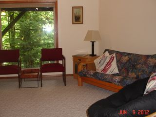 Kalama house photo - Sitting area (w/double sleeper futon) in lower den, large windows overlook river
