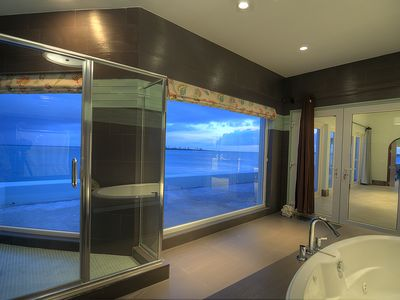 Master shower and bath tub facing the ocean