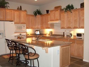 Prescott Valley house rental - Spacious Kitchen w granite counters, breakfast bar, tv, complete cooking tools