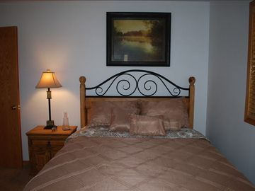 Guest bedroom with queen and flat panel TV