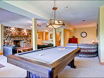 Pool Table and Spacious Couches in the Game Room
