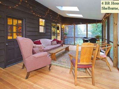 SCREENED-IN PORCH with newly-refinished floors.