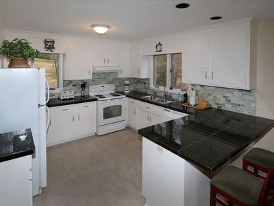 Newly renovated kitchen, granite-tile countertops