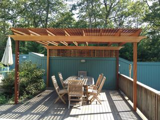 East Hampton house photo - New mahogany arbor for dining in shade