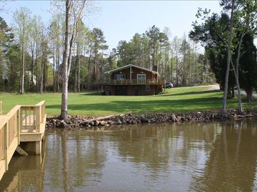 View of lake side of house from floating dock