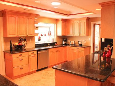 Large kitchen with granite counter tops and stainless steel appliences