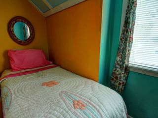 Tybee Island condo photo - Cozy twin bed tucked into alcove in 2nd bedroom also has a double bed.
