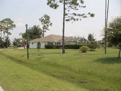 Rear view of the property and pool