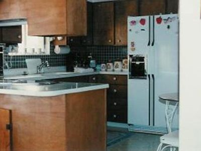 Kitchen over view, gas range, Side by side with Ice and kitchen table and chairs