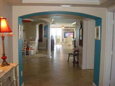 Foyer with formal dining area and great room with view of the ocean.