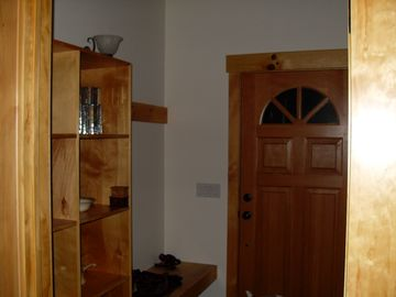 Entry way with bench, cubbies and coat closet