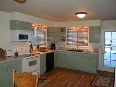 Great kitchen has everything; opens onto private patio, BBQ, dining sets, garden