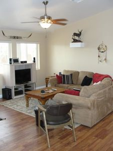 Comfy microfiber sectional and flat screen HDTV with DirecTV DVR service