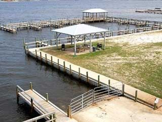 Boat launch and slips. Covered fishing pier. Gazebo with grilling area.