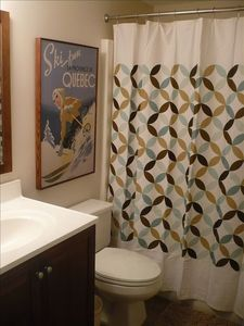 Bathroom with updated vanities