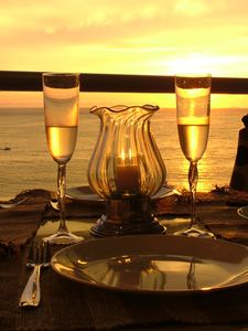 Imagine that sunset dinner with a glass of champagne. Cook services available.