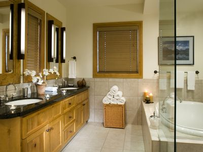 Bathroom with jetted tub and glass-walled shower