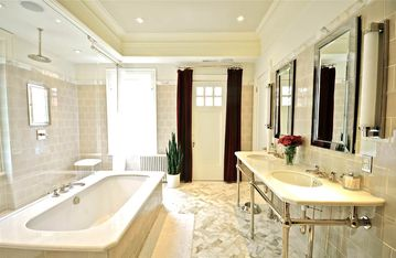Gorgeous master bathroom with dual shower and seperate toiletroom