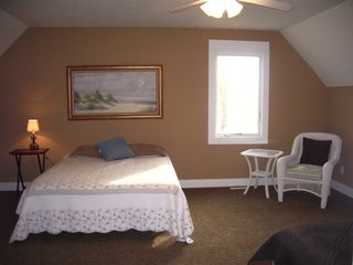 Montague cottage photo - One of two upper floor bedrooms, with queen and single (with trundle) beds