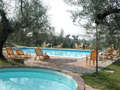 swimming pool with panoramic view on Chianti's hills