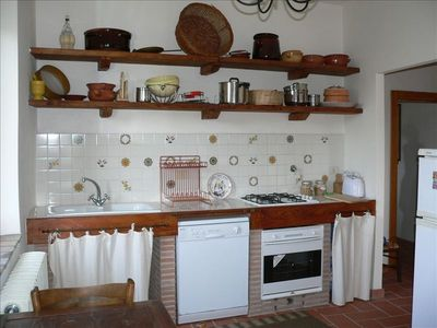 Sutri estate rental - Kitchen next to the livingroom, with 2 windows on the valley side