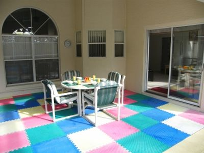 Doral Woods villa rental - Enjoy a meal outside in our covered lanaiwhile watching the kids in the pool