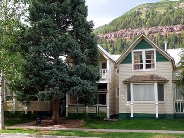 Telluride townhome rental - Columbine C - Exterior View (Behind Huge Spruce Tree) - 3 Bedrooms, 2.5 Baths