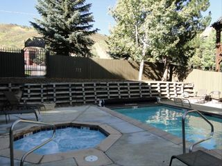 Snow Blaze condo photo - View of Year-Round Heated Pool with Ski Slope View
