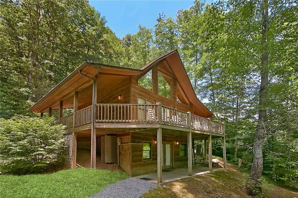Forest serenity with a community pool vrbo for Pigeon forge cabins with fishing