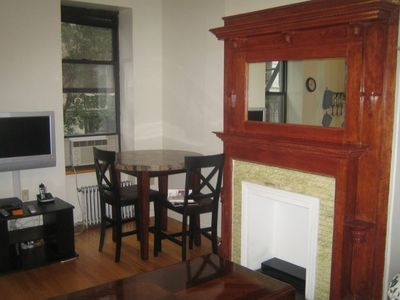 dining table, air conditioner, and fireplace