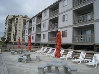 Ocean Drive Beach condo photo - Sun deck. Ready for outdoor dining or relaxing on the lounges.