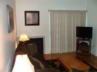 Weirs Beach condo photo - Flat screen TV with cable; slider opens to peeks of the lake