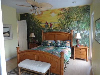 Master bedroom with own bathroom and hand painted tropical sunset scene