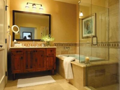 Each bedroom has a separate bathroom equipped with a tub and walk-in shower.