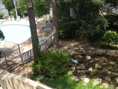 View from balcony of running brook & Condo Pool.